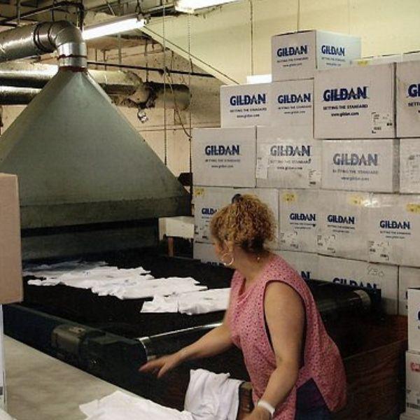Women at Guertin Graphics creating custom printed t-shirts